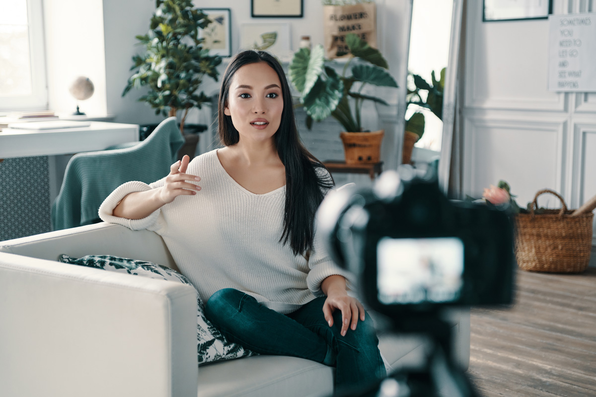 young woman explaining something while making new video for her blog