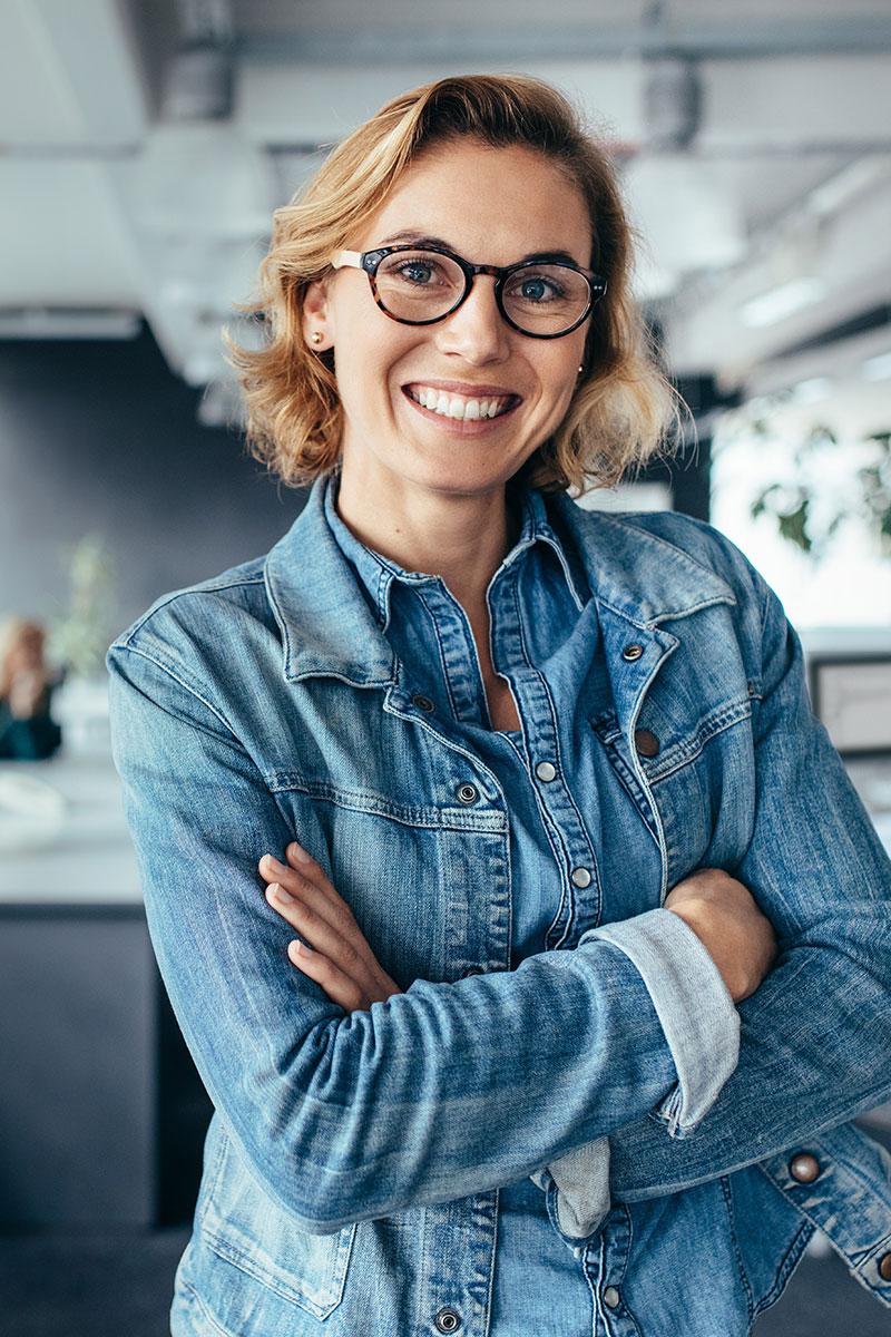 blonde woman wearing denim smiling