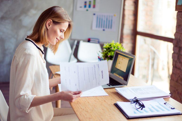 self employed woman doing paperwork
