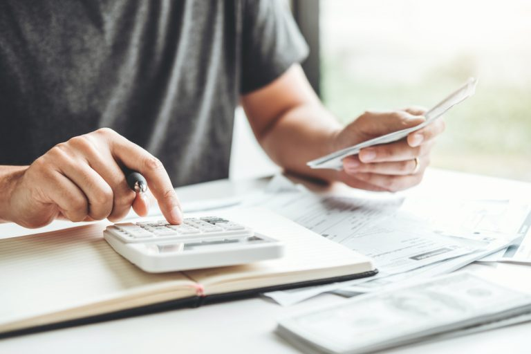 Man using calculator Accounting