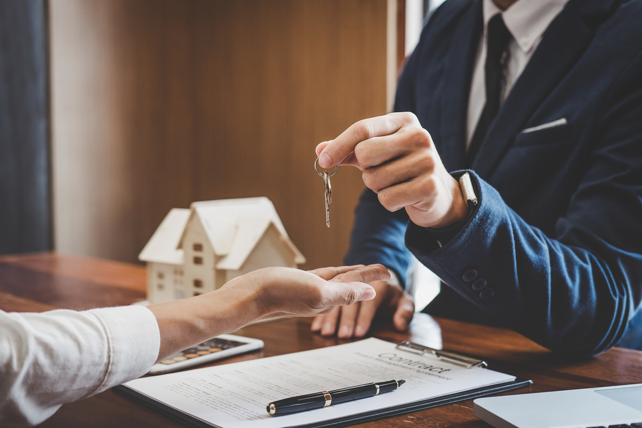Real estate agent Sales manager holding filing keys to customer after signing rental lease contract of sale purchase agreement, concerning mortgage loan offer for and house insurance
