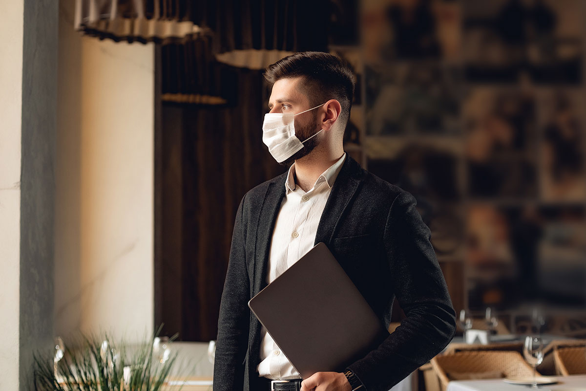 smart dressed man in restaurant with mask