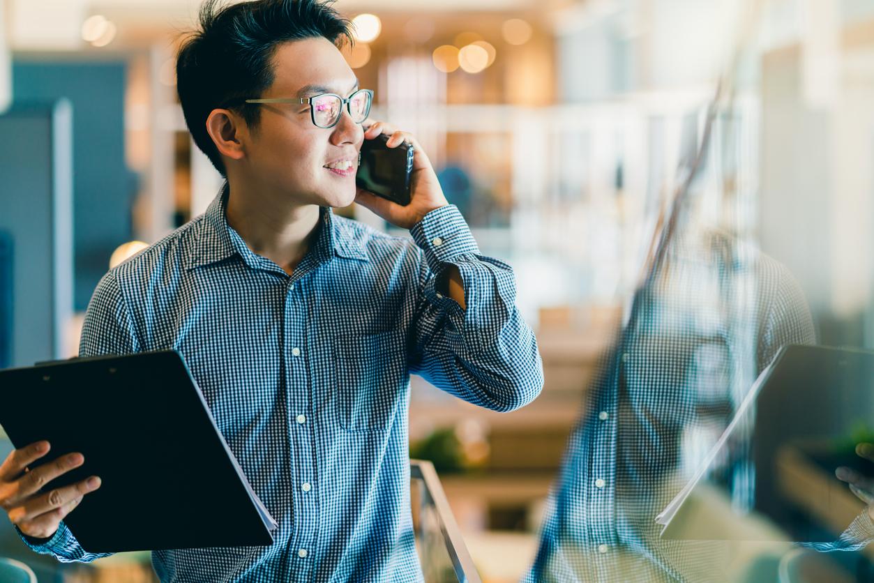 startup entrepreneur business owner businessman smile hand use smartphone woking in office background