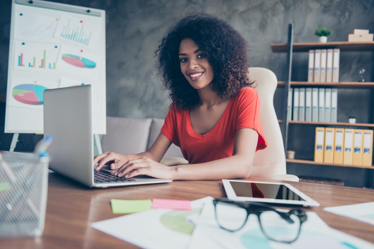 happy freelancer working on laptop