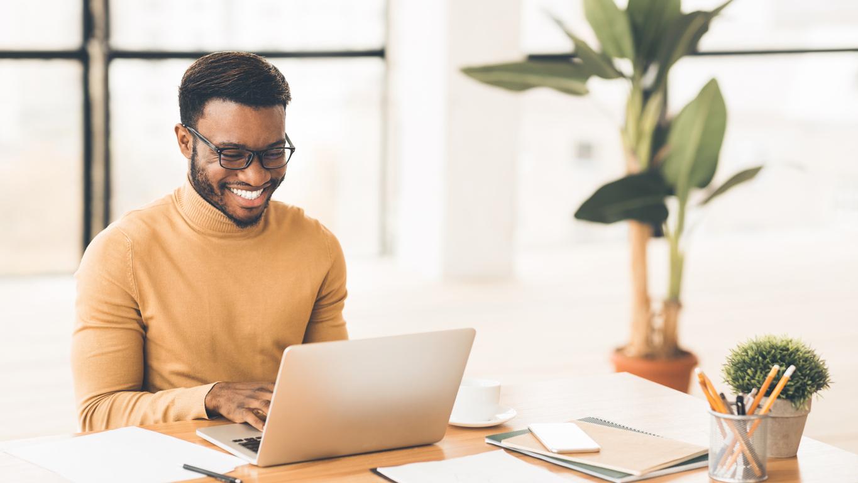 Headshot of guy using laptop