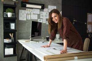 Smiling designer in her studio