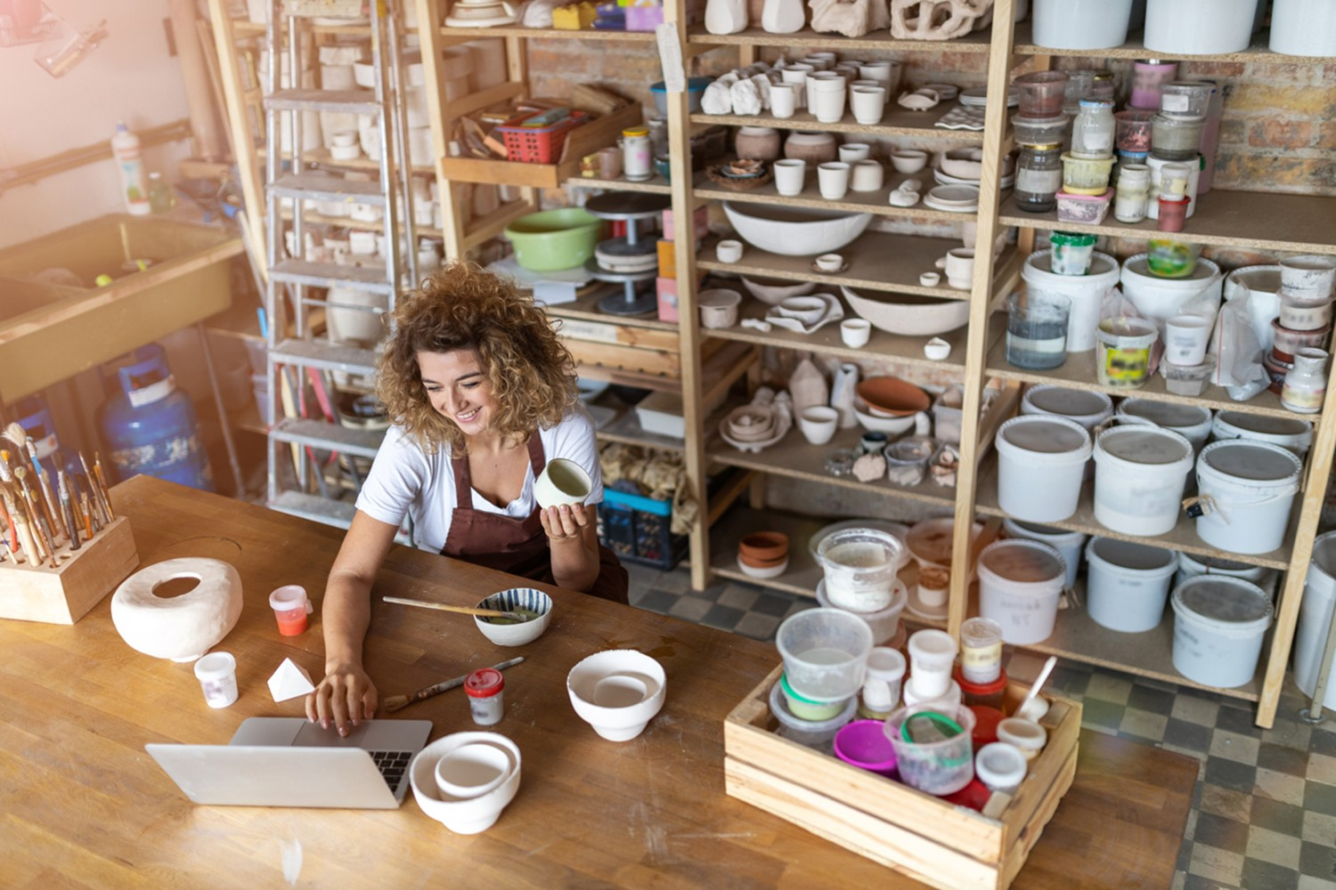 self employed woman surrounded by tools and materials